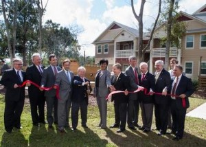 Leonard D. Simmons Jr. (fourth from left), board chair of the Renaissance Neighborhood Development Corporation, cuts the ribbon Thursday morning at the opening ceremony for the Bayou Cane Apartments in Houma.